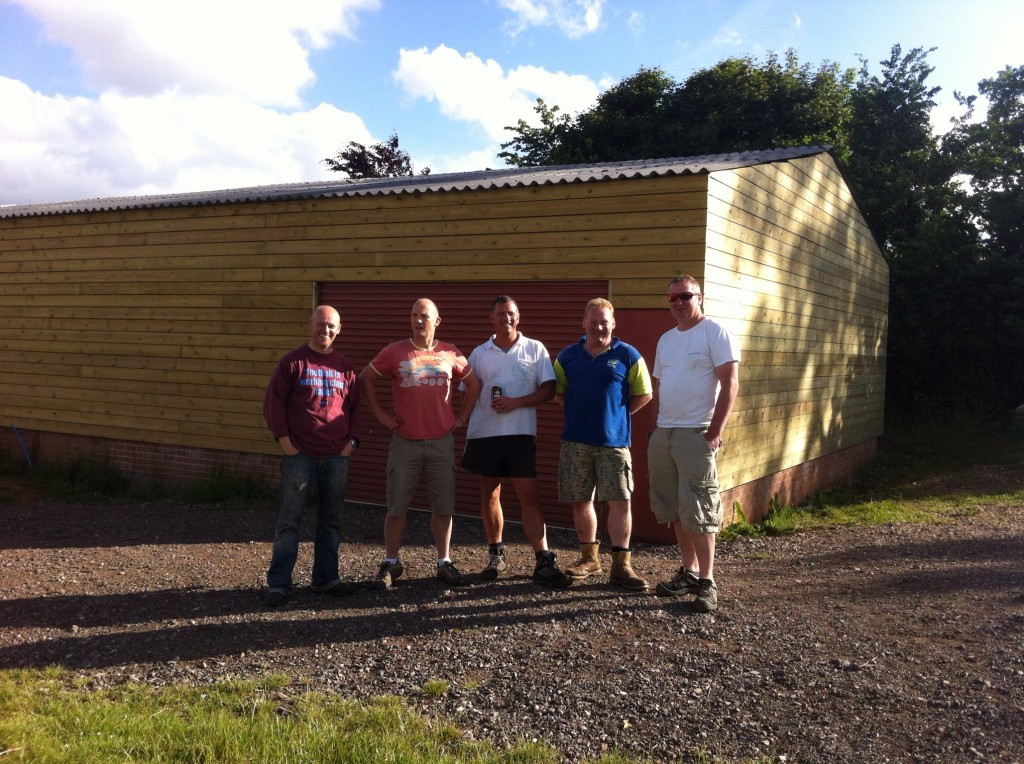 Just a few of the many people that have given up their weekends to clad the building and finish the decking.